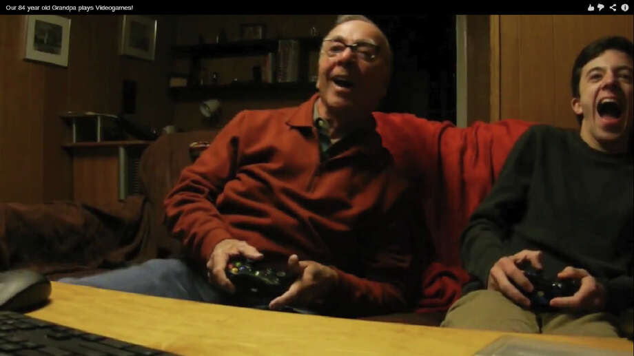 Darien High School junior Jake Heyde and his 84-year-old grandfather, Ben, take on the gaming world in a YouTube video that became an overnight sensation. Photo: Contributed Photo