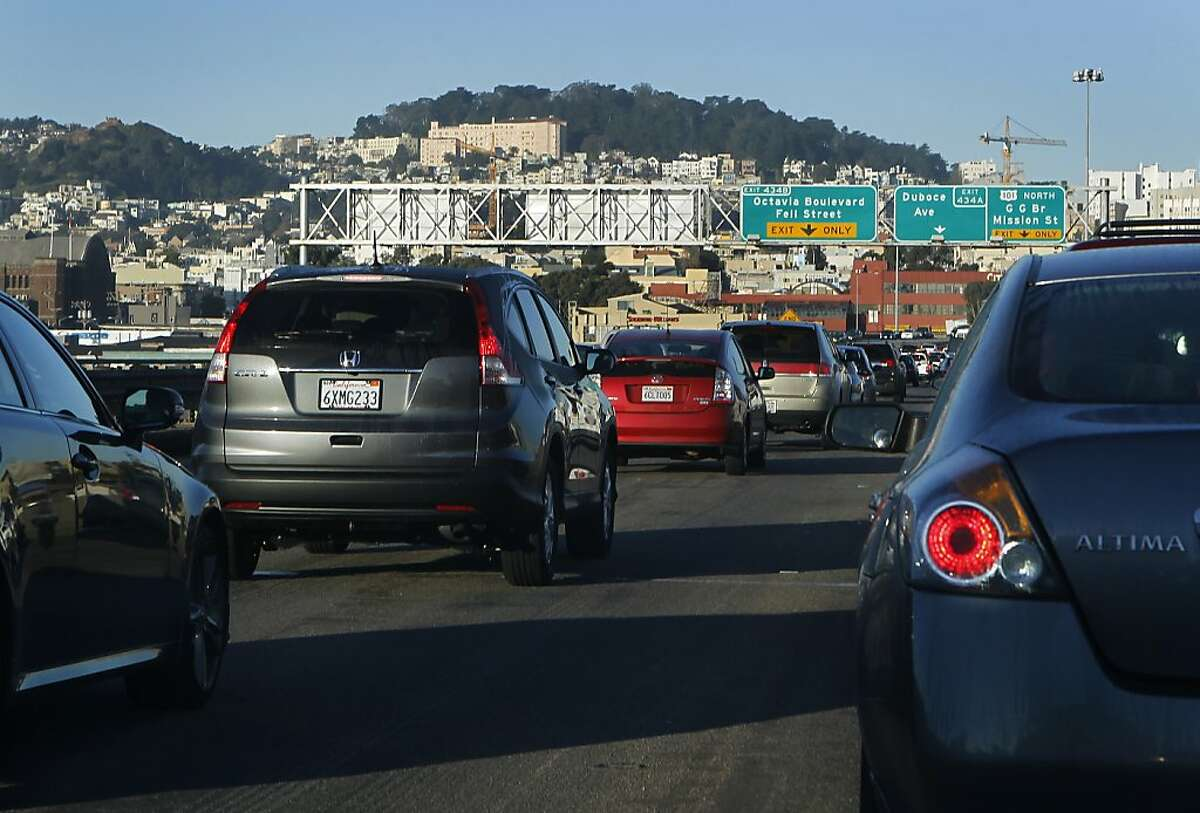 Commuters travel northbound on the Central Freeway where lane markers are barely visible in San Francisco.