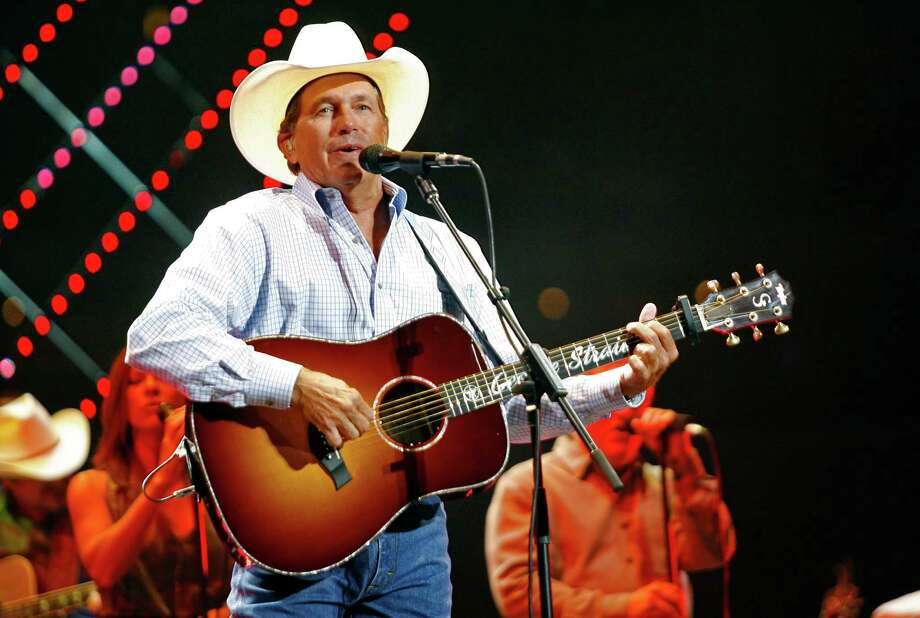 Country music entertainer George Strait performs at Cowboys Stadium, the first event held in the $1.1 billion stadium that opened in 2009 in Arlington. You can count on Strait, a native of Poteet, to deliver the twang in his songs. Photo: AP Photo/Mike Stone