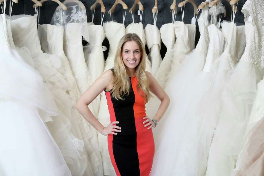 Boutique owner Luvi Wheelock, in front of wedding dresses at Casa de Novia, wears a Resort 2013 color-block knit dress by Narciso Rodriguez, $995, available at her Atrium Ready to Wear, 3331 D'Amico, 713-520-0206, atriumrtw.com Photo: Thomas B. Shea / © 2012 Thomas B. Shea