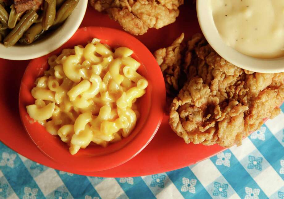 Jalapeno fried chicken with sides of macaroni and cheese and green beans from Radicke's Bluebonnet Grill, 237 N WW White Rd, (210) 337-4007. Photo: WILLIAM LUTHER, SAN ANTONIO EXPRESS-NEWS / WILLIAM LUTHER