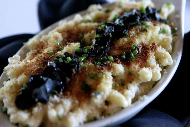 Wildfish's Truffled Macaroni and Cheese doesn't stint on the truffle flavor in this dish, which comes from white summer truffle oil, nor on the Parmigiano-Reggiano cheese, which melts into the trumpet-shaped campanelle pasta. A béchamel sauce seasoned with scallions adds delicious richness; toasted bread crumbs on the top add a wonderful crunch. Shaved black truffles are the finishing touch. Photo: HELEN L. MONTOYA, SAN ANTONIO EXPRESS-NEWS / hmontoya@express-news.net