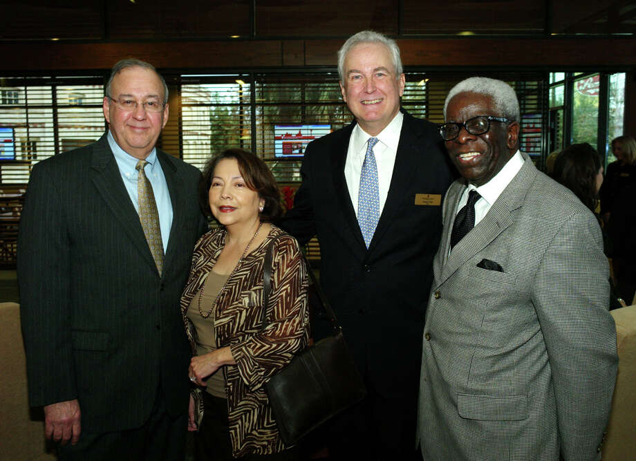 San Antonio Area Foundation reception: Supporters  Joe and Olga Lozano (from left) get together with CEO Dennis Noll and  former CEO Reggie Williams during the reception celebrating the San  Antonio Area Foundation's new location at the Pearl Brewery.