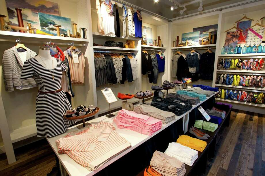J. Crew offshoot Madewell recently debuted at Market Street in The Woodlands. Below: The denim bar at the new store. Photo: Brett Coomer, Houston Chronicle / © 2013 Houston Chronicle