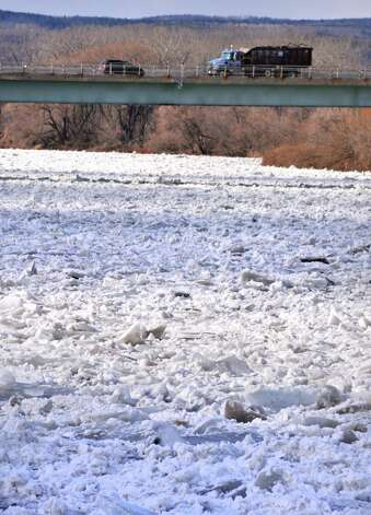 Traffic on the Western Gateway Bridge crosses an ice jam on the Mohawk River at the Stockade in Schenectady Thursday Jan. 31, 2013.  (John Carl D'Annibale / Times Union) Photo: John Carl D'Annibale / 00020994A