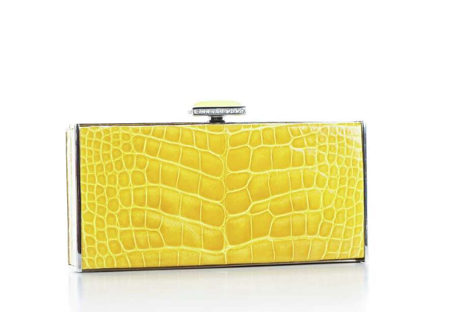 Sunflower crocodile clutch: Comes in a variety of colors and can fit a smartphone; $3,495. Photo: Michael Paulsen, Staff / © 2013 Houston Chronicle