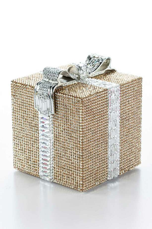 Gift package crystal minaudière: Wrapped in rows of crystal and topped with a deco crystal bow; $4,695. Photo: Michael Paulsen, Staff / © 2013 Houston Chronicle