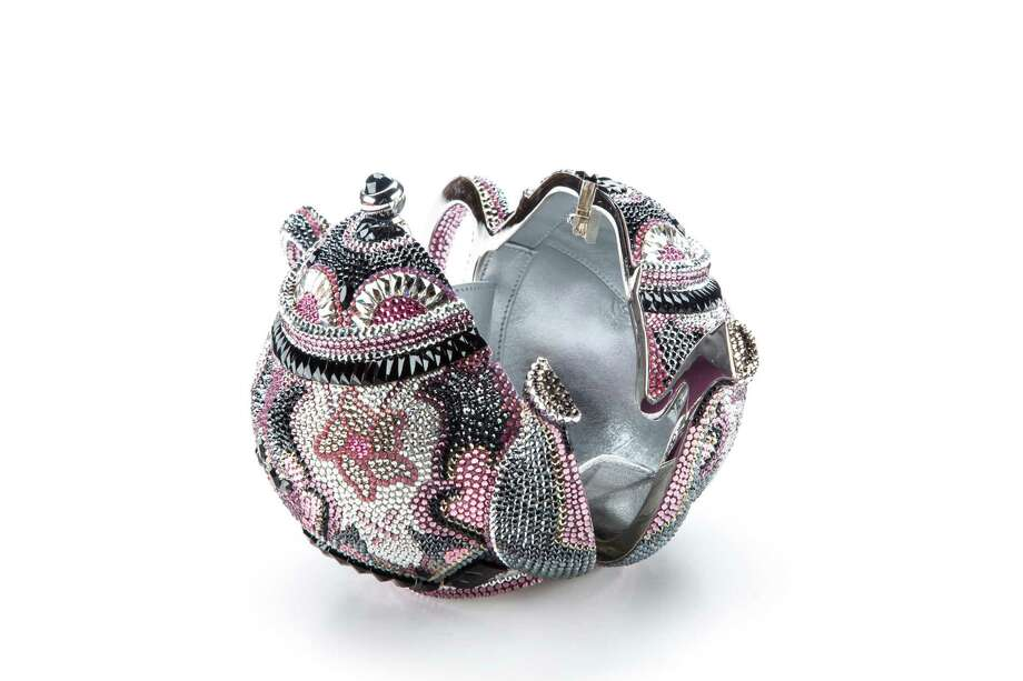 Earl Grey teapot minaudière: New novelty bag inspired by speakeasy teapots with top-snap closure and kidskin leather lining; $5,995. Photo: Michael Paulsen, Staff / © 2013 Houston Chronicle