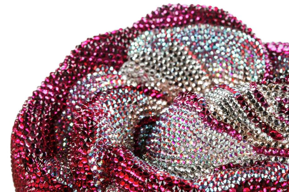 American Beauty rose clutch: Adorned with Austrian crystals and comes with a 19-inch chain; $5,995. Photo: Michael Paulsen, Staff / © 2013 Houston Chronicle
