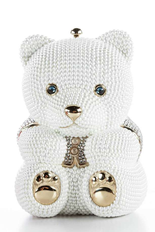 Sweetheart Bear crystal minaudière: Novelty hand-beaded white crystal bear with bright blue eyes and double-sided design; $4,695 Photo: Michael Paulsen, Staff / © 2013 Houston Chronicle