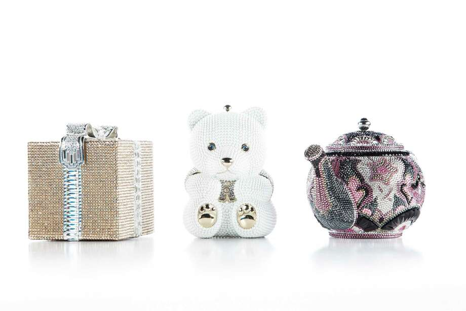 Judith Leiber handbags: gold/silver present bag, $4,696, left to right, teddy bear bag, $4,695, teapot bag, $5,995, at Neiman Marcus, photographed in the Houston Chronicle Photo Studio, Tuesday, Jan. 22, 2013, in Houston. ( Michael Paulsen / Houston Chronicle ) Photo: Michael Paulsen, Staff / © 2013 Houston Chronicle