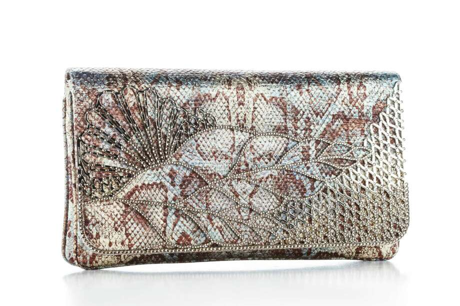 Ombre python Victoria: Python clutch saturated in ombre-effect deep blue with a deco crystal bar ornament; $4,295. Photo: Michael Paulsen, Staff / © 2013 Houston Chronicle