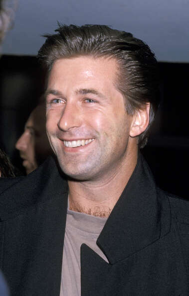 Baldwin in 1989, with that recognizable Jack Donaghy grin.