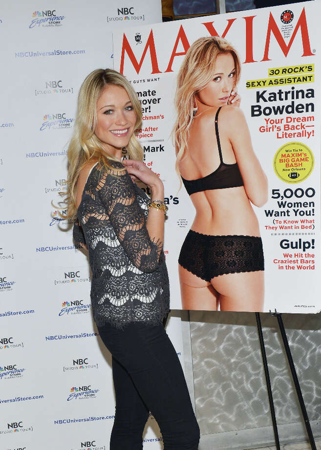 Bowden signs copies of her ''Maxim'' cover issue Jan.18, 2013. In 2011, she was voted Esquire's ''sexiest woman alive.''  Photo: Slaven Vlasic, Getty Images / 2013 Slaven Vlasic