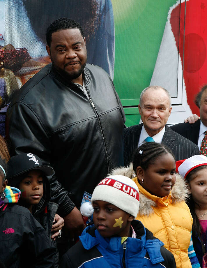 Grizz Chapman with New York City Police Commissioner Ray Kelly and a bunch of kids at a toy drive in New York City in 2012.  Photo: Andy Kropa, Getty Images / 2012 Andy Kropa