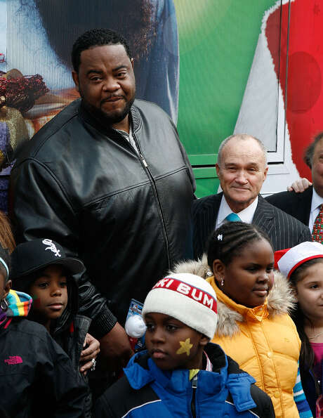 Grizz Chapman with New York City Police Commissioner Ray Kelly and a bunch of kids at a toy drive in