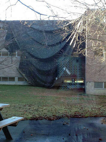 A photo from the FLHS Prospect Facebook page shows damaged portions of the roof at Fairfield Ludlowe High School covered with tarps. Photo: Contributed Photo / Fairfield Citizen