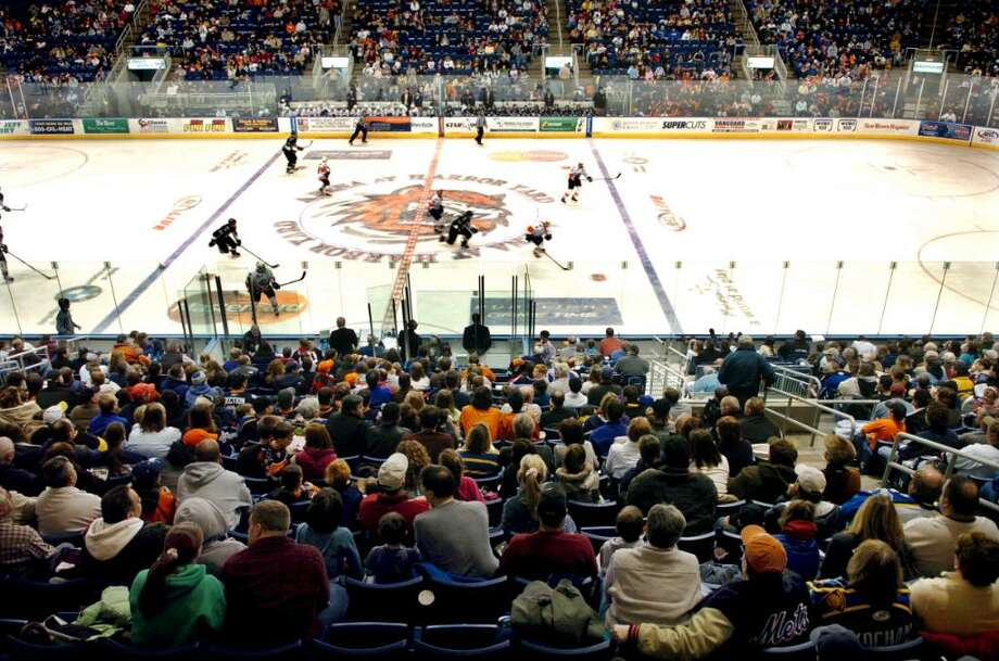 A good sized crowd attended a Sunday game in January 2009, between the Soundtigers and Scranton/Wilkes-Barre at the Arena at Harbor Yard in Bridgeport. Photo: Brian A. Pounds / Connecticut Post