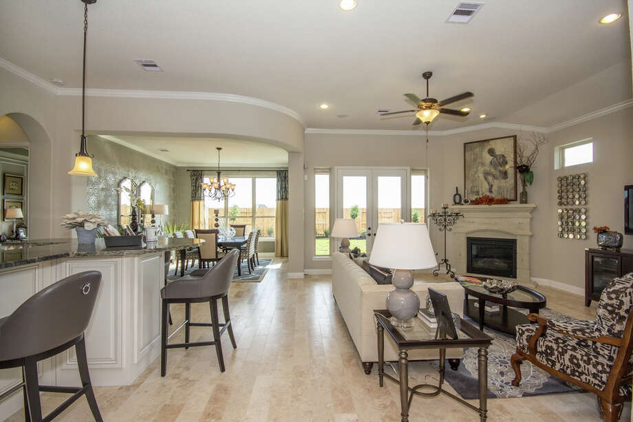 In Cinco Ranch, new patio home models by Village Builders (shown) and David Weekley are across the street from a lake and park, and near shopping.