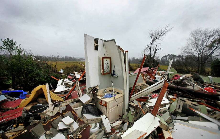 The remnants of a bathroom stand amidst the wreckage of a destroyed home after a tornado struck, Wednesday, Jan. 30, 2013, in Adairsville, Ga. A fierce storm system that roared across Georgia has left at least one person dead after it demolished buildings and flipped vehicles on Interstate 75 northwest of Atlanta. Photo: David Goldman, AP / AP