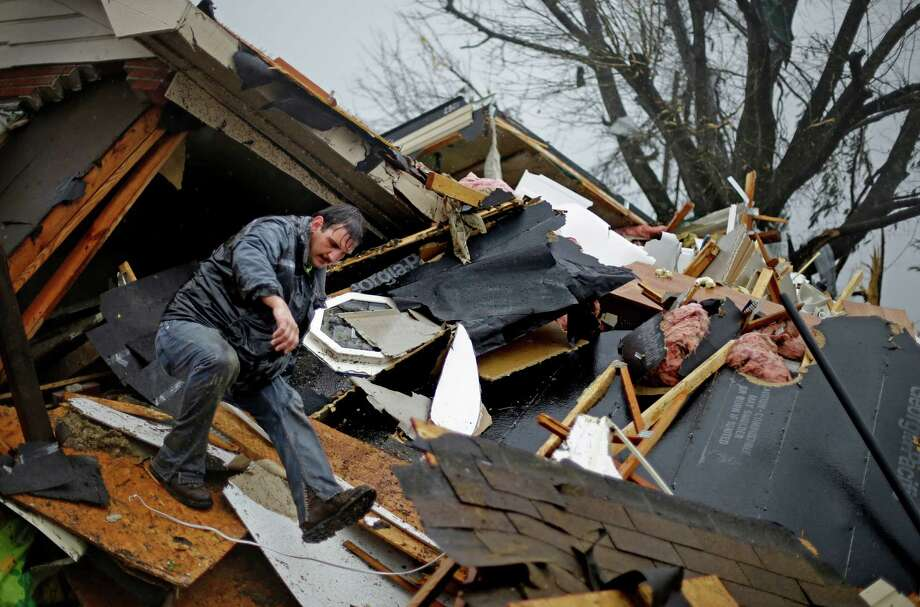 Nathan Varnes, of Cartersville, Ga., helps search a destroyed home for a dog after a tornado struck, Wednesday, Jan. 30, 2013, in Adairsville, Ga. A fierce storm system that roared across Georgia has left at least one person dead after it demolished buildings and flipped vehicles on Interstate 75 northwest of Atlanta. Photo: David Goldman, AP / AP