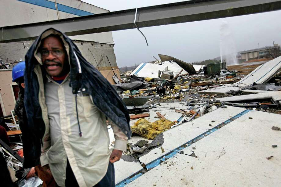Workers look for personal belongings following a tornado at the Daiki plant, a metal fabrication company, Wednesday, Jan. 30, 2013, in Adairsville, Ga. A fierce storm system that roared across Georgia has left at least one person dead after it demolished buildings and flipped vehicles on Interstate 75 northwest of Atlanta. Photo: David Goldman, AP / AP