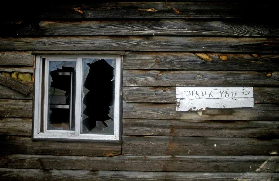 A sign hangs next to a damaged window outside a barbecue restaurant after a tornado struck, Wednesday, Jan. 30, 2013, in Adairsville, Ga. A fierce storm system that roared across Georgia has left at least one person dead after it demolished buildings and flipped vehicles on Interstate 75 northwest of Atlanta. Photo: David Goldman, AP / AP