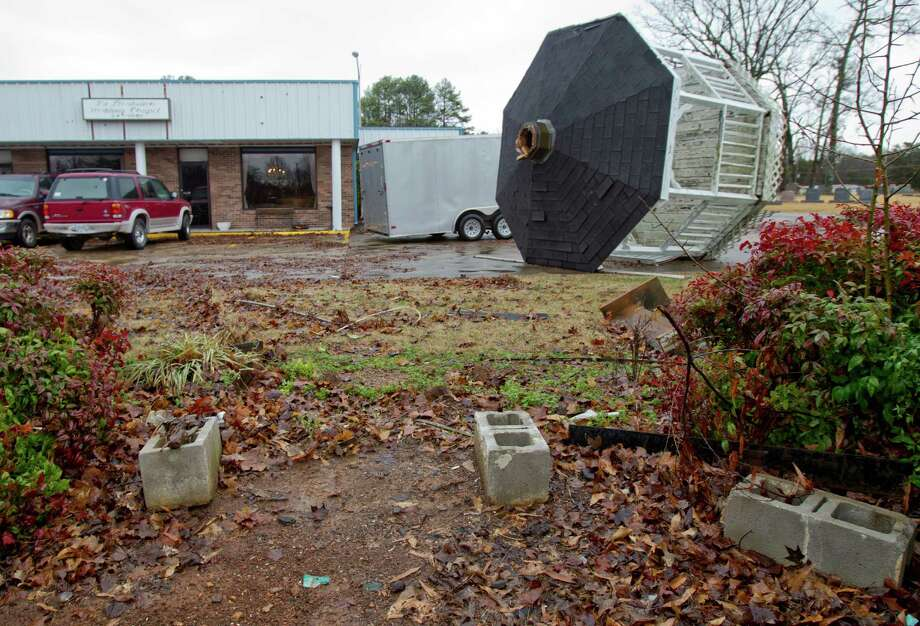 A gazebo lies on it's side in a parking lot of the Plantation Wedding Chapel in Rogersville, Ala. Wednesday Jan. 30, 2013. after being blown from it's foundation by the severe thunderstorms that roared across the Tennessee Valley over night. Photo: Matt McKean, AP / The TimesDaily