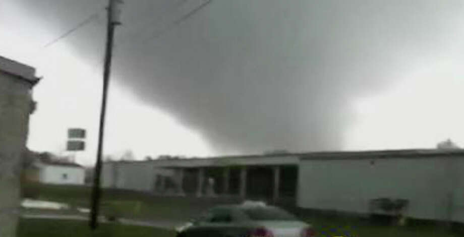 In this image made from video and released by WSB TV in Atlanta, a tornado moves through the town of Adairsville, Ga. on Wednesday, Jan 30, 2013. A fire chief says a storm that roared across northwest Georgia has left overturned vehicles on Interstate 75 northwest of Atlanta, and crews are responding to reports of people trapped in storm-damaged residential and commercial buildings. (AP Photo/WSB TV) MANDATORY CREDIT Photo: AP / WSB TV