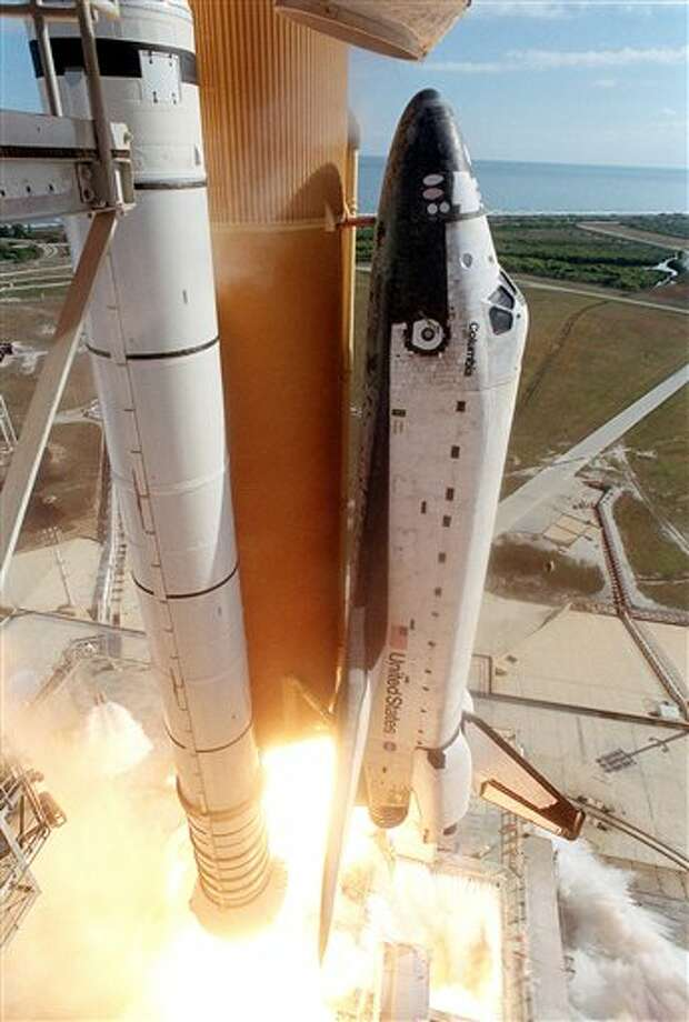 In this Jan. 16, 2003 file photo, the space shuttle Columbia lifts off from the Kennedy Space Center in Cape Canaveral, Fla. Space shuttle Columbia broke apart in flames 200,000 feet over Texas on Saturday, Feb. 1, 2003, killing all seven astronauts just minutes before they were to glide to a landing in Florida. (AP Photo/Chris O'Meara)