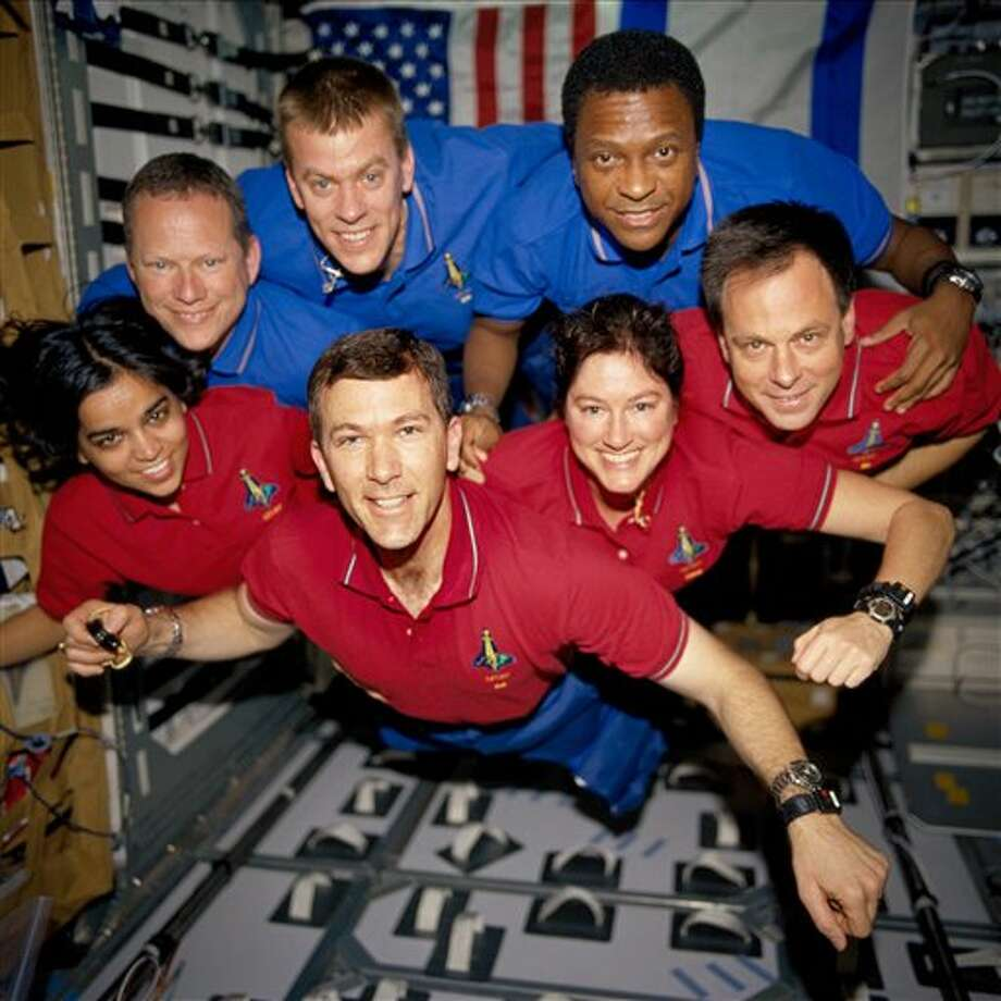 It's been 10 years since the Space Shuttle Columbia disintegrated in the Texas skies Feb. 1, 2003, while headed for a landing at Kennedy Space Center. From the left (bottom row), wearing red shirts to signify their shift's color, are astronauts Kalpana Chawla, mission specialist; Rick D. Husband, mission commander; Laurel B. Clark, mission specialist; and Ilan Ramon, payload specialist. From the left (top row), wearing blue shirts, are astronauts David M. Brown, mission specialist; William C. McCool, pilot; and Michael P. Anderson, payload commander. Ramon represents the Israeli Space Agency. (AP Photo/NASA, File) / AP2003