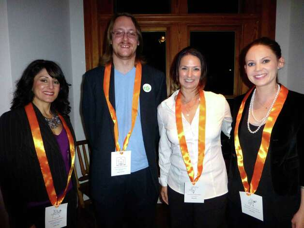 Artist Foundation grant winners Kyndra Vigil (from left), Nathan Thurman, Wendy Ellis and Sara Frantz greet each other after awards were announced recently during a ceremony at the Liberty Bar. Photo: Nancy Cook-Monroe