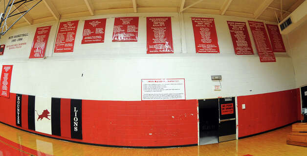 Several championship banners hang on the walls in the gym at Kountze High School. The Lions are ranked as the No.1 team in 2A. Photo taken Monday, January 28, 2013 Guiseppe Barranco/The Enterprise Photo: Guiseppe Barranco, STAFF PHOTOGRAPHER / The Beaumont Enterprise
