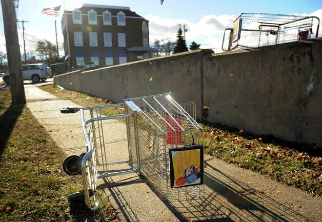 Shopping carts are blown from the parking lot outside Xpect Discounts at the intersection of High Street and the Post Road in Milford on Thursday, January 31, 2013. Photo: Brian A. Pounds