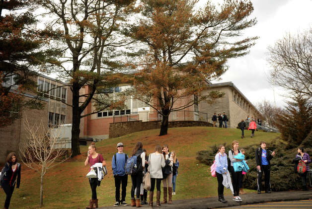 Students wait to be picked up outside Fairfield Ludlowe High School where a wind damaged roof resulted in an early dismissal on Thursday, January 31, 2013. Photo: Brian A. Pounds