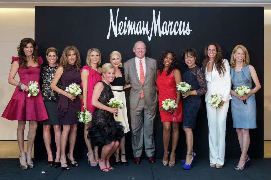 The 2013 Houston Chronicle Best Dressed honorees pose for a picture at Neiman Marcus, Wednesday, Jan. 30, 2013, in Houston.  Melissa Mafrige Mithoff, left to right, Greggory Burk, Sima Ladjevardian, Stephanie Cockrell, Rosemary Schatzman, Isabel David, Houston Chronicle Chairman Jack Sweeney, Tiffany Avery Smith, Merele Gail Yarborough, Lisa Holthouse and Susan Krohn. Photo: Michael Paulsen, Houston Chronicle / © 2013 Houston Chronicle