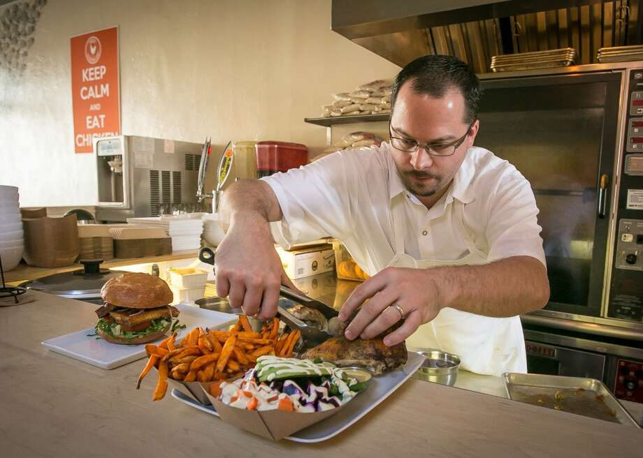 Chef/owner Chris Laramie plates a dish.