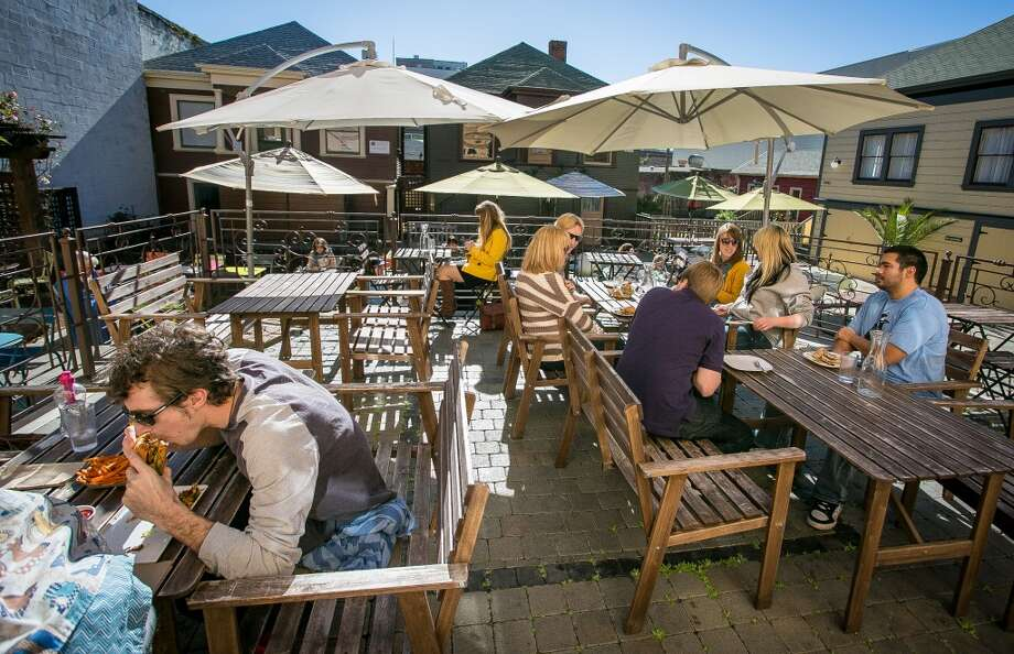 Diners enjoy lunch on the patio at Brasa.