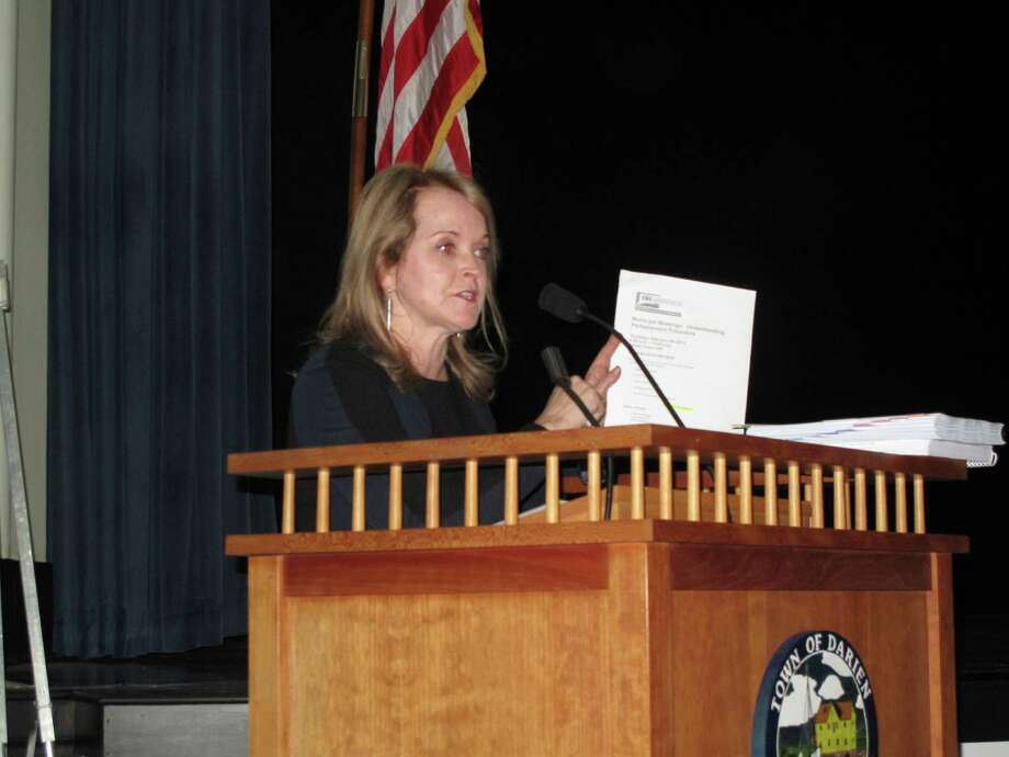 RTM moderator Sarah Seelye displays the 2013-2014 budget at the Jan. 28 RTM meeting at Darien Town Hall. Photo: Tyler Woods