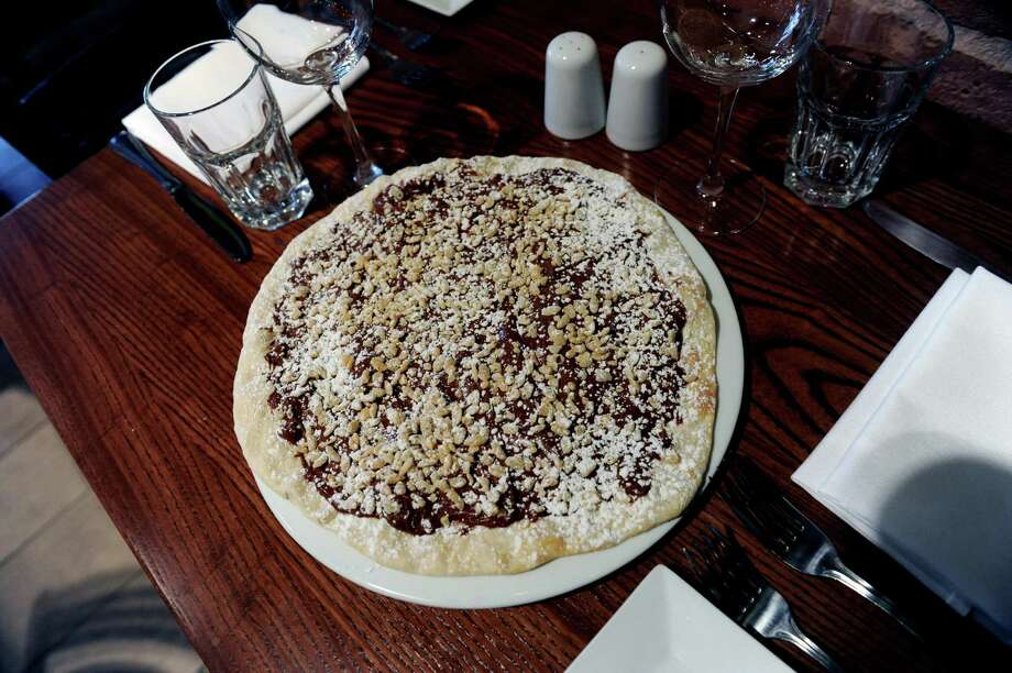 A CiocCotto, a chocolate pizza, was made at Cotto Wine Bar Pizzeria, a new Italian restaurant has opened in Stamford, Conn., Thursday, Jan.31, 2013. Photo: Helen Neafsey / Greenwich Time