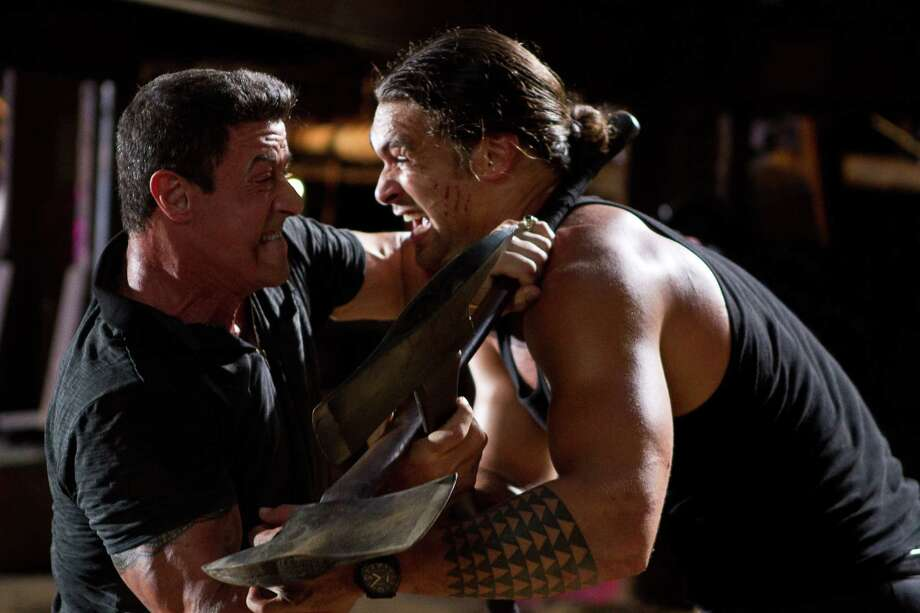 "Sylvester Stallone, left, and Jason Momoa are locked in a life-or-death struggle in ""Bullet to the Head."" Photo: Frank Masi, HOEP / Warner Bros. Pictures"