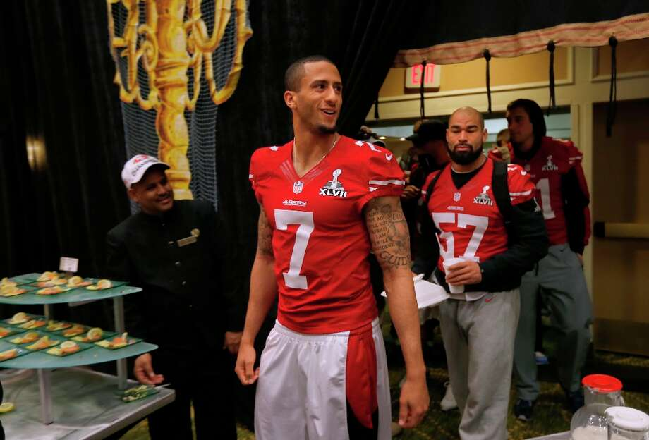 49ers' quarterback Colin Kaepernick leads the parade of players into the daily press conference on Thursday Jan. 31, 2013, in New Orleans, La. The San Francisco 49ers and the Baltimore Ravens prepare for this Sunday's NFL Superbowl match up. Photo: Michael Macor, The Chronicle / ONLINE_YES