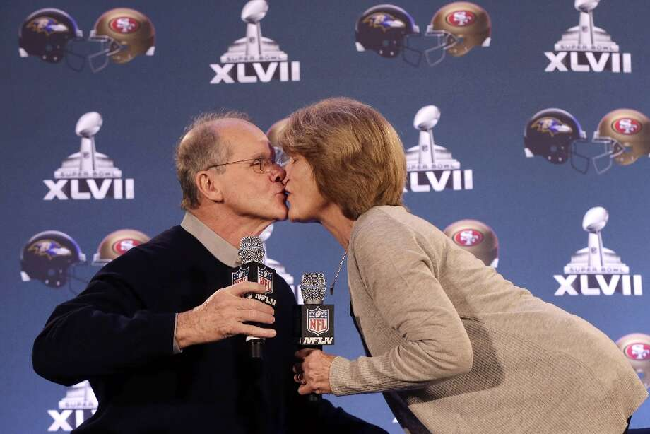 Jack and Jackie Harbaugh, parents of Baltimore Ravens head coach John Harbaugh and San Francisco 49ers head coach Jim Harbaugh, kiss during a news conference, Wednesday, Jan. 30, 2013, for NFL football's Super Bowl XLVII in New Orleans. Their sons will be coaching against each other in the Super Bowl on Sunday. Photo: Gerald Herbert, Associated Press / AP