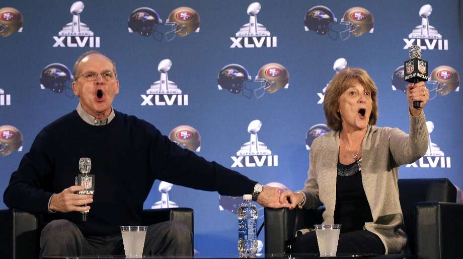 Jack and Jackie Harbaugh, parents of Baltimore Ravens head coach John Harbaugh and San Francisco 49ers head coach Jim Harbaugh, yell out a family cheer during a news conference, Wednesday, Jan. 30, 2013, for NFL football's Super Bowl XLVII in New Orleans. Their sons will be coaching against each other in the Super Bowl on Sunday. Photo: Gerald Herbert, Associated Press / AP