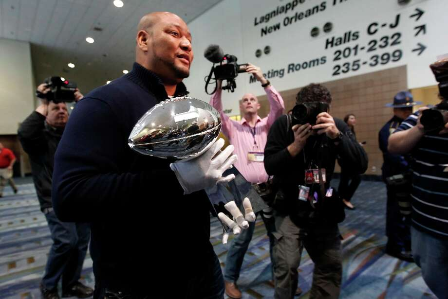 Former New Orleans Saints' running back great Deuce McAllister carries the Lombardi Trophy on Wednesday Jan. 30, 2013, to a waiting display case inside the NFL Experience Hall in New Orleans, La. The trophy will be given to the winning team, the San Francisco 49ers or the Baltimore Ravens, the winner of next Sunday's Super Bowl. Photo: Michael Macor, The Chronicle / ONLINE_YES