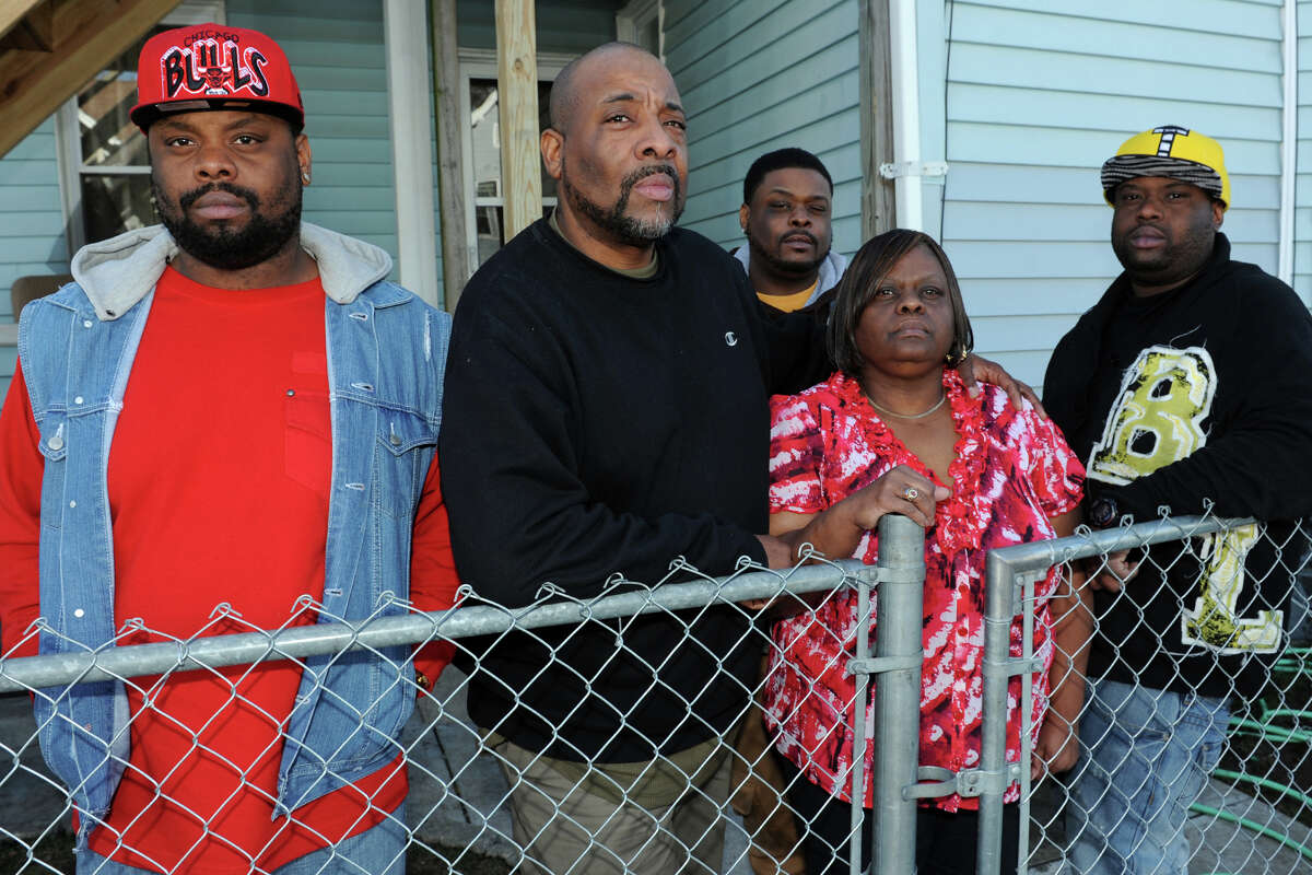 Horace and Margaret Jennings stand with their three sons, (l-r) Eric, Dennis and Bernard outside their house on Pleasant Street, in Bridgeport, Conn., Jan. 31st, 2013. The Jennings have filed a complaint following an incident last week when Horace Jennings was tasered by Bridgeport Police officers outside the family home. All five of the Jennings were arrested during the incident.