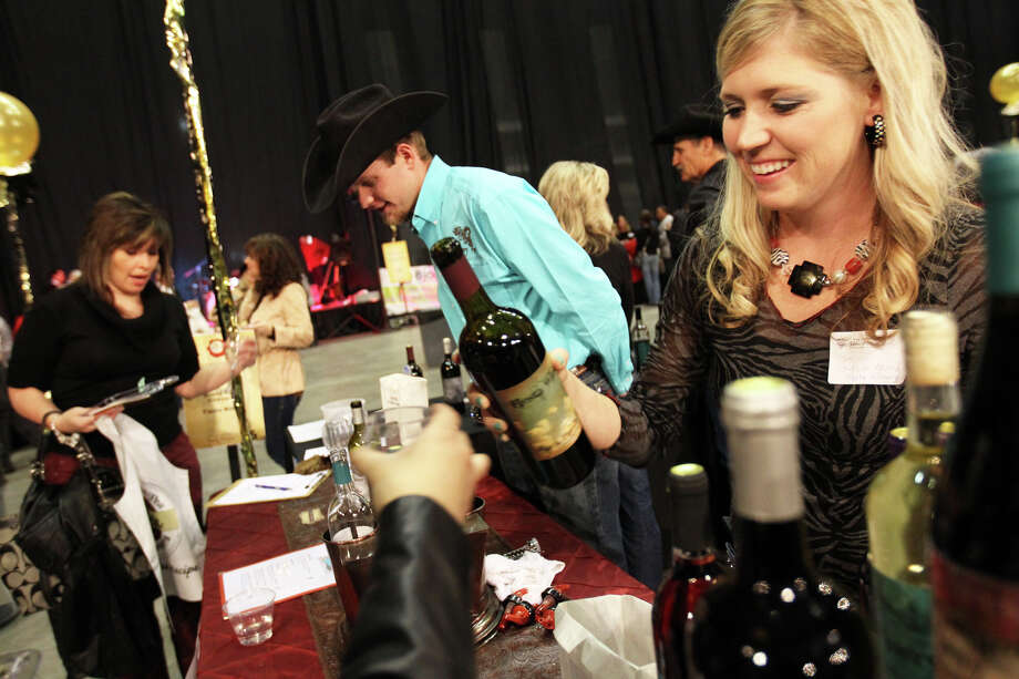 Savannah McCoury of Fiesta Vineyard & Winery in Lometa pours a taste of wine during last year's KLRN Wine Festival at the Alamodome. Photo: JENNIFER WHITNEY, SPECIAL TO THE EXPRESS-NEWS / SAN ANTONIO EXPRESS-NEWS