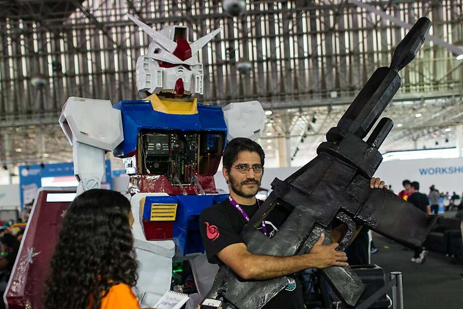 I just use it for hunting, Sen. Feinstein: Alexandre Ferreira, robot builder, poses with his Japanese animation-inspired creation and a really big gun during the Campus Party tech event in Sao Paulo, Brazil. Photo: Yasuyoshi Chiba, AFP/Getty Images