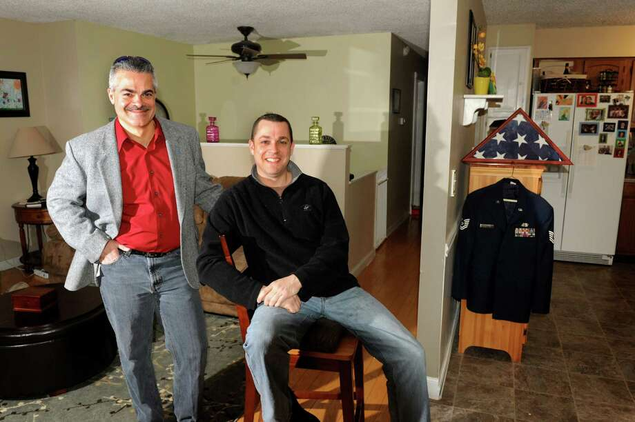 Realtor James Papaliosas, left, and homeowner Paul Gaffney at his home on Tuesday, Jan. 29, 2013, in Latham, N.Y. Both men are retired from the Air Force. (Cindy Schultz / Times Union) Photo: Cindy Schultz / 00020939A