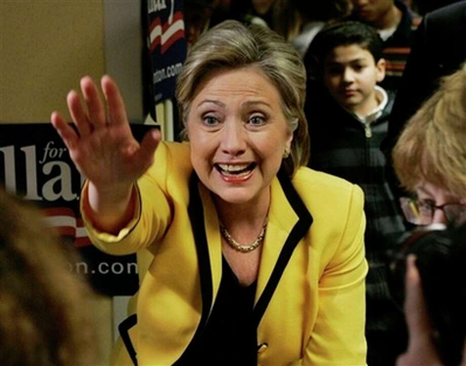 Democratic presidential hopeful, Sen. Hillary Rodham Clinton, D-N.Y., waves as she thanks volunteers at her campaign headquarters in Boston Monday, Feb. 4, 2008, one day before the primary elections on Super Tuesday.wld Photo: Elise Amendola, AP / AP
